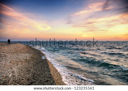 High dynamic range of sunset on beach - stock photo