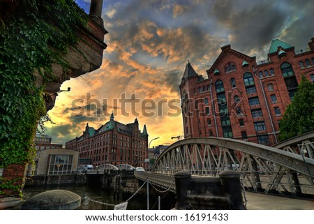 high dynamic range or hdr image of Speicherstadt in Hamburg, Germany. architecture at dusk or dawn. (tourist and harbor area). - stock photo
