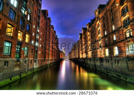 high dynamic range or hdr image of speicherstadt in Hamburg, Germany. architecture at dusk or dawn. (tourist area near harbor). - stock photo