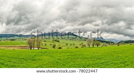 High dynamics range scene with rainy clouds - stock photo
