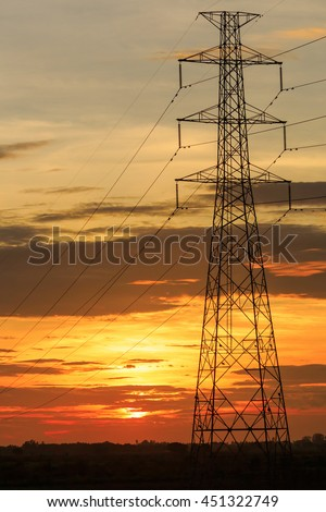 High electric pole at sunset background