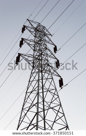 high electric pole with cable on evening light