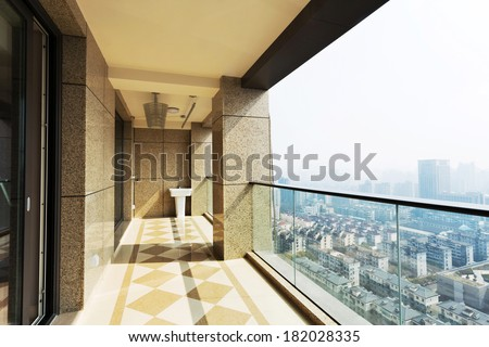 high end balcony in downtown of  modern city - stock photo