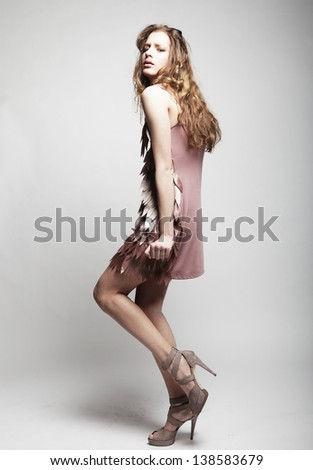 High-End Fashion Model with curly hair - stock photo