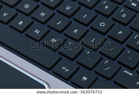 High end laptop computer black keyboard - stock photo