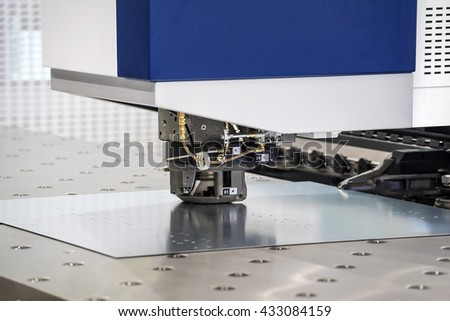 High-end machine for automatic punching metal sheet. Serie of metal processing machines - stock photo