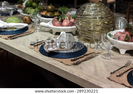 High-End Table Setting with Fine Cutlery, Glassware and Cloth Napkins - stock photo