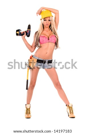 High fashion glamour model in Daisy duke shorts, tool belt, pink bra and yellow hard hat with a screw gun