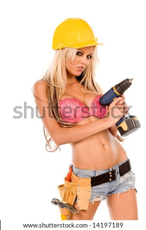 High fashion glamour model in Daisy duke shorts, tool belt, pink bra and yellow hard hat with a screw gun - stock photo
