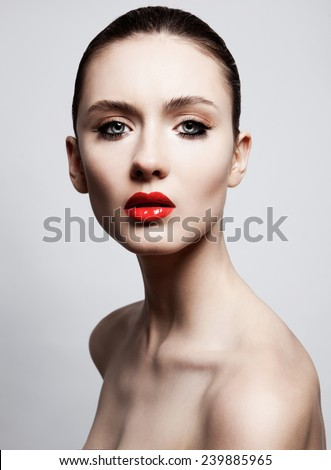 High fashion look.glamor beauty portrait of beautiful Caucasian young woman model with bright makeup with perfect clean skin with colorful red lips and lashes  - stock photo