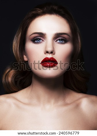 High fashion look.glamor beauty portrait of beautiful Caucasian young woman with red lips - stock photo