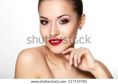 High fashion look.glamor closeup portrait of beautiful sexy  Caucasian young woman model with  red lips,bright makeup, eye arrow makeup with Perfect clean skin. white teeth - stock photo