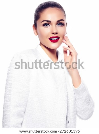 High fashion look.glamor closeup portrait of beautiful sexy smiling stylish brunette business young woman model with bright makeup with red lips in white coat jacket - stock photo