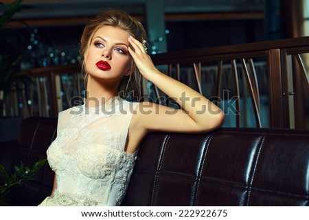 High fashion look.glamor closeup portrait of beautiful sexy stylish  blond bride young woman model with bright makeup, with red lips,  with perfect clean skin in wedding dress - stock photo