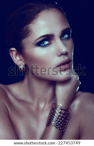 High fashion look.glamor closeup portrait of beautiful sexy stylish blond Caucasian young woman model with bright makeup, with perfect clean skin with blue eyes with accessories - stock photo