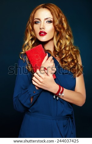 High fashion look.glamor closeup portrait of beautiful sexy stylish blond Caucasian young woman model with bright makeup with red lips, with perfect clean skin with colorful accessories in blue cloth - stock photo