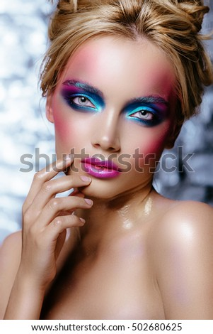 High fashion look.glamor closeup portrait of beautiful sexy stylish blond young woman model with bright makeup and pink lips with perfect clean skin. Advertising Space