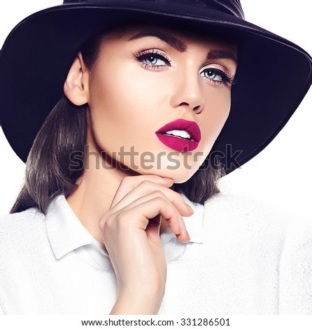 High fashion look.glamor closeup portrait of beautiful sexy stylish brunette business young woman model with bright makeup with pink lips in white coat jacket in french hat - stock photo