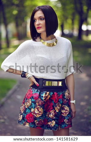 High fashion look.glamor closeup portrait of beautiful sexy stylish brunette Caucasian young woman model with bright makeup, with pink lips, in bright summer cloth in the park - stock photo