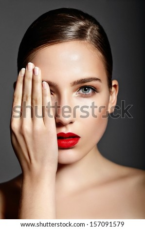 High fashion look.glamor closeup portrait of beautiful sexy stylish brunette Caucasian young woman model with bright makeup, with red lips,  with perfect clean skin in studio - stock photo