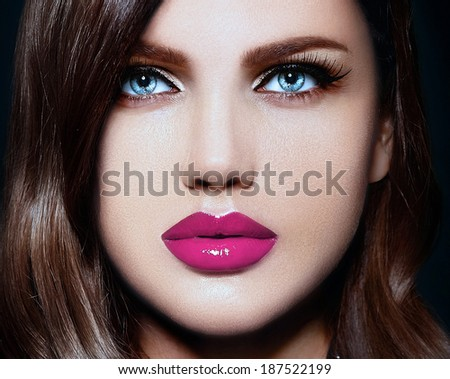 High fashion look.glamor closeup portrait of beautiful sexy stylish Caucasian young woman model with bright makeup, with pink natural lips,  with perfect clean skin with blue eyes - stock photo