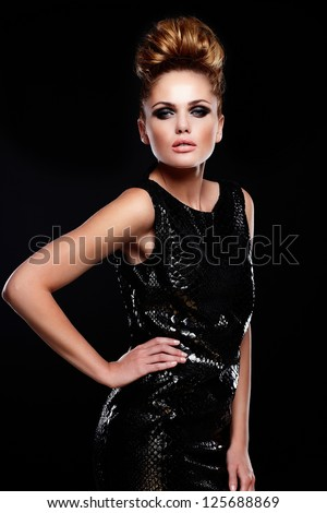 High fashion look.glamor portrait of beautiful sexy stylish Caucasian young woman female model in black dress with bright makeup and hairstyle - stock photo