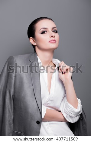 High fashion look glamor portrait of beautiful sexy stylish Caucasian young woman model in a white shirt. Professional Make up for Brunette - stock photo