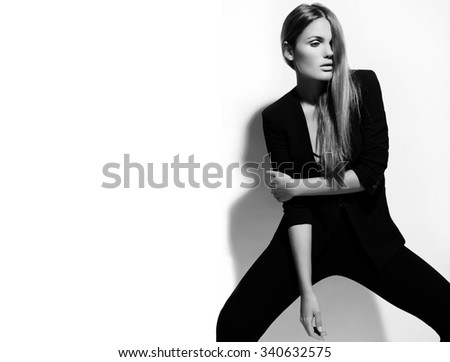 High fashion look.glamor portrait of beautiful sexy stylish Caucasian young woman model in black cloth isolated on white - stock photo