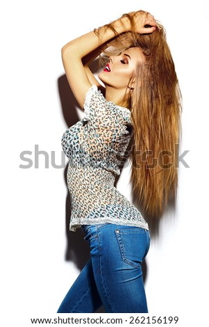 High fashion look.glamor sexy stylish blond young woman model with bright makeup with perfect sunbathed clean skin in colorful hipster casual summer cloth with hair in hands - stock photo
