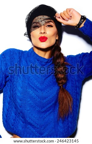 High fashion look.glamor stylish beautiful  young woman model with red lips  in blue sweater hipster cloth giving kiss - stock photo