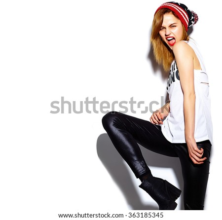 High fashion look.glamor stylish beautiful  young woman model with red lips  in hipster cloth in colorful beanie - stock photo