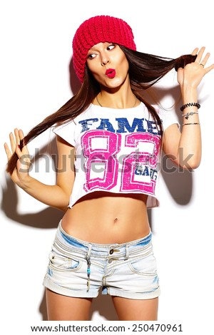 High fashion look.glamor stylish beautiful  young woman model with red lips  in summer bright colorful  hipster cloth in red beanie  - stock photo