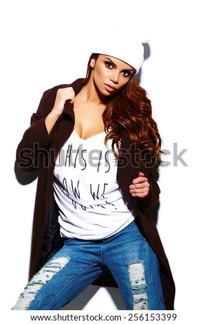 High fashion look.glamor stylish sexy beautiful  young brunette woman model  in summer bright  hipster cloth in white beanie in coat - stock photo