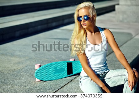 High fashion look.glamor stylish sexy beautiful young cute blond model girl in summer bright casual hipster clothes with skateboard  - stock photo