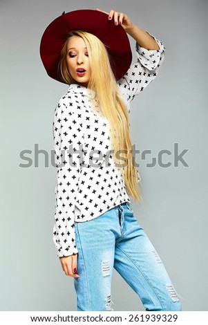 High fashion look.glamor stylish sexy smiling beautiful young blond woman model in summer bright jeans hipster cloth  in red hat - stock photo