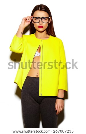 High fashion look.glamor stylish sexy smiling beautiful young woman model in summer bright casual  hipster cloth in yellow coat in glasses - stock photo