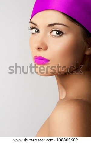 High fashion look.glamour fashion beautiful  American woman model with pink bright lips with pink material on head isolated on gray - stock photo