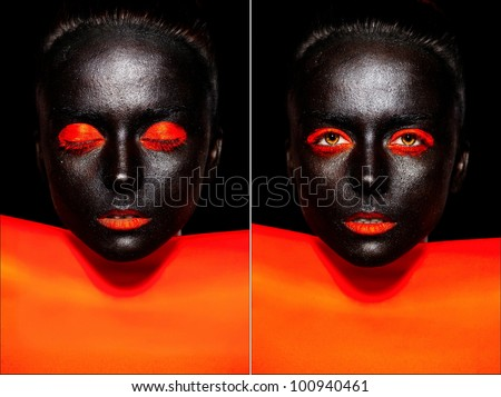 High fashion look.glamour fashion beautiful black American woman in black mask with orange bright makeup and orange lips with orange material - stock photo