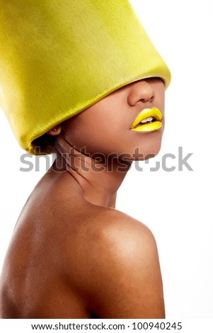 High fashion look.glamour fashion beautiful black American woman with yellow bright lips with yellow material on head isolated on white - stock photo