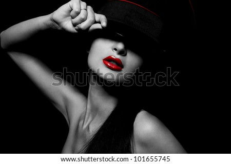 High fashion look.glamour portrait of beautiful sexy young female woman with red lips on black background with hat - stock photo