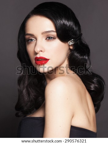 High fashion look.glamour portrait of beautiful sexy young female woman with red lips on dark grey background