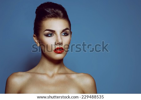 High fashion look. Portrait of a fashionable model with sexy red lips, beautiful naked shoulders and perfect skin. Close up. Studio shot - stock photo