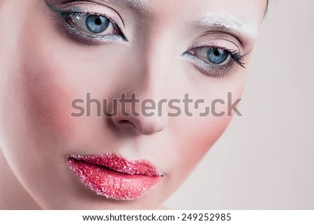 High fashion look. Portrait of beautiful young woman with  bright make-up and with perfect clean skin.
