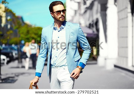 High fashion look.Young stylish confident happy handsome businessman model  in suit cloth lifestyle in the street in sunglasses - stock photo