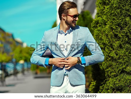 High fashion look.Young stylish confident happy handsome businessman model in suit clothes lifestyle in the street in sunglasses - stock photo