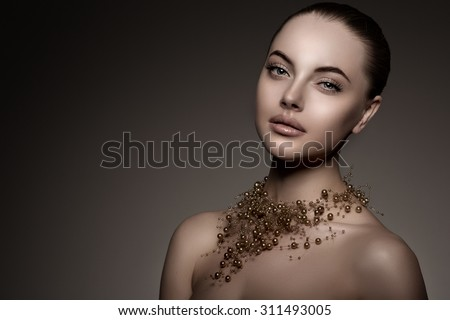 High-fashion Model Girl Beauty Woman high fashion Vogue Style Portrait beautiful fashionable Luxury lady precious jewelry of pearls around neck necklace  Stylish Makeup Make up Perfect skin eyes lips - stock photo