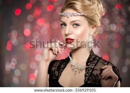 High-fashion Model Girl Beauty Woman high fashion Vogue Style Portrait fashionable Luxury lady jewelry diamond necklace Stylish Makeup Make up Perfect skin red lips blurred lights Bokeh backlight - stock photo