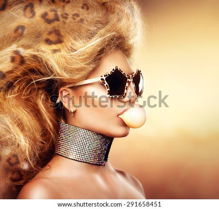 High Fashion Model Girl Portrait wearing sunglasses. Beauty Woman with Holiday Leopard Makeup, Beautiful accessories. Modern updo hair style. Bubble Gum - stock photo