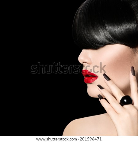 High Fashion Model Girl Portrait with Trendy Fringe Hair style, Make up and Manicure. Long Black Fringe Hairstyle, Black Matte Nail Polish and Red Matte Lipstick. Woman Makeup. Sexy Lips. Haircut - stock photo