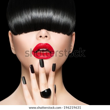 High Fashion Model Girl Portrait with Trendy Hair style, Make up and Manicure. Long Black Fringe Hairstyle, Black Matte Nail Polish and Red Matte Lipstick. Woman Makeup. Sexy Lips. Haircut.